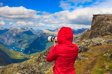 Tourist taking photo from Dalsnibba area Norway