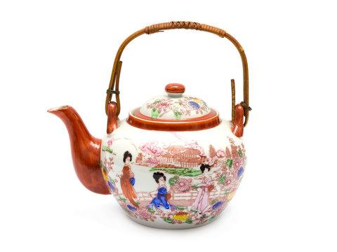 Eine Teekanne mit asiatischer Malerei