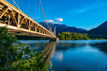 Suspension bridge in mountains