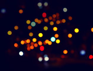 Color bokeh of light city street. Night city. Abstract background.