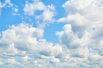 Porous clouds in the blue sky. Nature background.