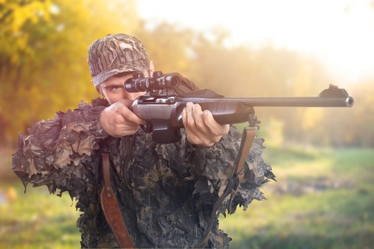 Male Hunter with Rifle on white background