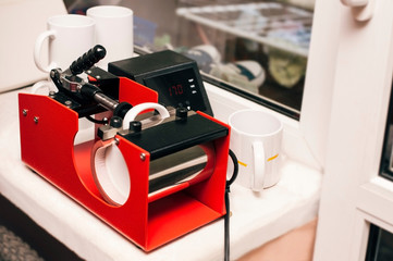 The thermopress for cups is intended for transfer of the image, a logo, the photo, an inscription on mugs, cups