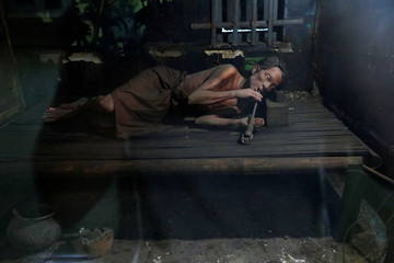 A mock-up of a man smoking opium is seen at the Drug Elimination museum in Yangon