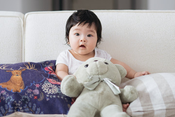 Cute 5 months old sitting on a sofa