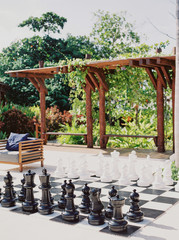 A game of life size chess outdoors