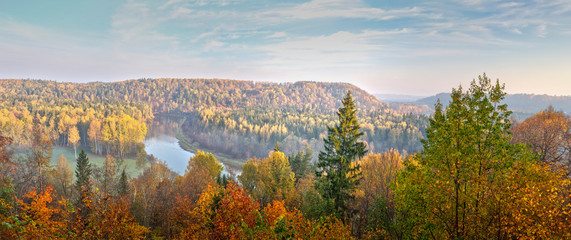 Beautiful view across the river, on autumn colorful bright trees Latvia