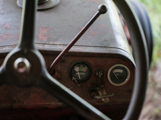 Detail: water & oil guages on old tractor.