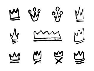 Doodles set of hand drawn crowns. Vector illustration