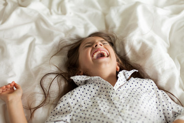 Child with a wide-mouth laugh
