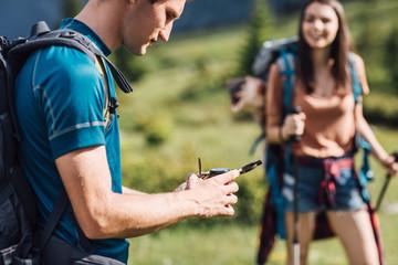 Hiker Using Compass