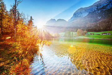 Hintersee - Amazing Alpine Lake in Germany, Bavaria Bundes land, Austria border. Picturesque scenery of lovely sunrise on the lake in Alps mountains. Scenic Seasonal Autumn Landscape Photography.