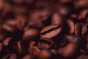 Cafe design, pictures for bars and cafes. Closeup coffee grains on burlap and brown background.