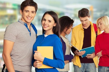Group of students with books on background