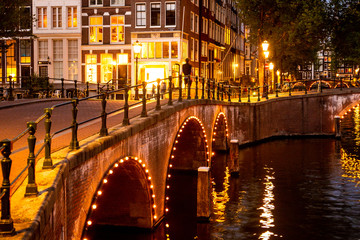 Wall Mural - Beautiful night scene from the City of Amsterdam in the Netherlands with canals and lights