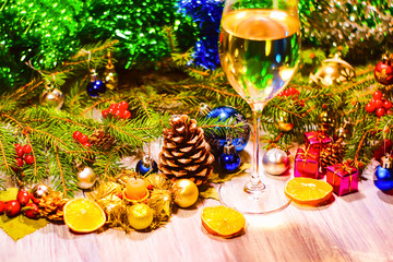 a glass of champagne or white wine on a new year background, Christmas decorations