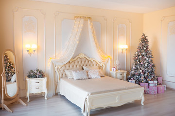 Classic Christmas decorated interior room with New year tree. Modern luxury design apartment bedroom with bed. Christmas eve at home