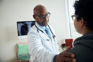 Doctor speaks with patient