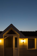 Real estate agent and mortgage investment.the summer house concept in the night.