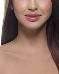Cosmetics, makeup and trends. Bright lip gloss and lipstick on lips. Natural lip makeup. Beautiful part of female face. Perfect clean skin in red light