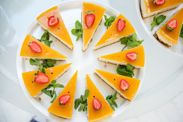 Delicious, juicy, fresh yellow cake with fresh strawberries