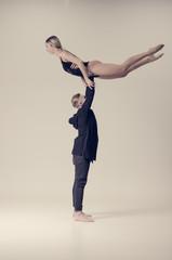 acrobat sensual dancers on empty background