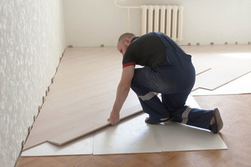 installation, installation, installation of laminate strips over old linoleum with a substrate. Repair, updating the surface of the floor without dismantling the old coating.