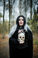 Picture of witch girl with skull in hands