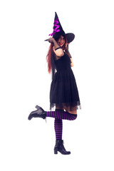 Image of witch in black dress and hat