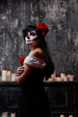 Photo of woman with white make-up and roses on face