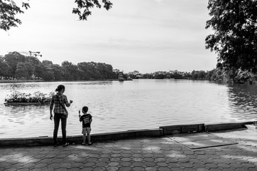 Contemplating the lake with an ice cream in Hanoi, Vietnam