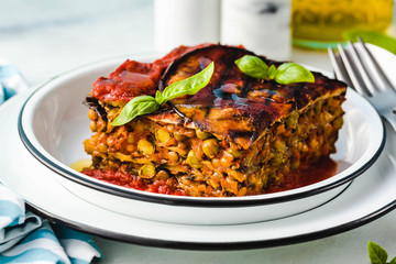 gluten free vegan lasagna. from grilled eggplant, green peas, lentils and vegetables. delicious healthy comfort food for the whole family for the holidays. italian parmigiana