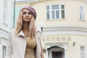 Beautiful fashionable woman in retro style is on the street