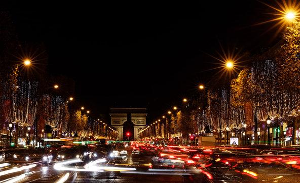 Paris, France - November 25, 2017: Avenue des Champs-Elysees with Christmas lights leading up to the Arc de Triomphe in Paris, France