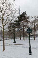 Paris, France - February 7, 2018: Eiffel tower and champs de mars covered with snow