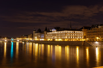 Paris, France - February 18, 2018: View of the Conciergerie on the Ile de la Cite in Paris by night from Pont neuf bridge