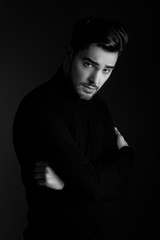 Portrait of handsome man posing, black and white photography