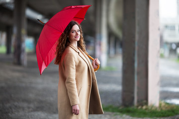 Young ginger woman with umbrella