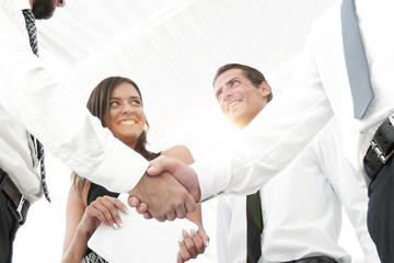 background image of handshake of business partners.