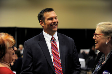 Republican gubernatorial candidate Kris Kobach greets supporters at his election night party in Topeka