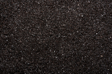 The texture of the earth.The background of the black earth.Chernozem.
