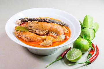 River prawn spicy soup (Tom yum koong) Thai food and ingredient vegetable