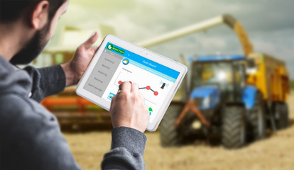 Hand holding Tablet Monitoring Smart farming system , Agriculture technology revolution, AI automatic, Conceptual