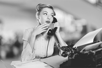 Obraz Attractive young woman speaking on  vintage phone - fototapety do salonu