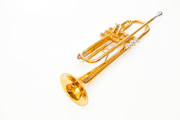 Close up of trumpet on white background. Detail of old trumpet instrument.