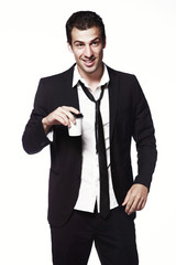 A young guy in a black suit with a coffee Cup on a white background. Advertising, creativity. Coffee to go.