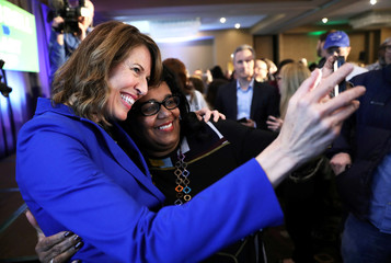 Democratic congressional candidate Cindy Axne (left) takes a photo with West Des Moines City Councilwoman Renee Hardman while appearing at her midterm election night party in Des Moines, Iowa