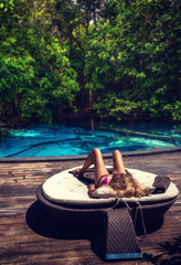 Beautiful woman relaxing by poolside