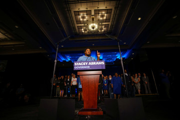 Stacey Abrams speaks to the crowd of supporters announcing they will wait till the morning for results of the mid-terms election at the Hyatt Regency in Atlanta