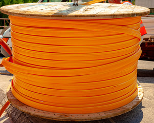 fiber optic cables wires on wooden spool